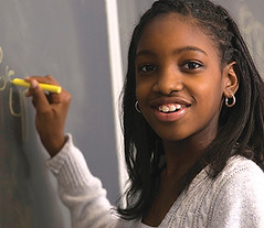 Student doing math on chalk board (BostonFoundation) Tags: school girl smile childhood youth person stand chalk kid student education child hand classroom african board think young diversity grade class study american mathematics write lesson iq chalkboard ethnic blackboard primary educate learn pupil elementary quiz count schoolwork preteen schoolchild greenboard