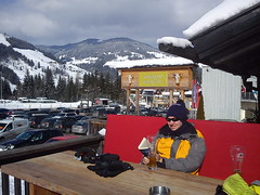 Relaxing (traveling peter) Tags: wood trees winter red portrait sky orange white snow mountains alps salzburg cars me beer glass hat sunglasses sign clouds bench table lunch outdoors reading restaurant glasses austria book parkinglot europe sitting skiing parking lifeofpi gray goggles jacket gloves skiresort february graysky skier slope skiarea pongau stjohannimpongau wagrain hohetauern wheatbeer tauern amade weissbeer skiwelt 2013 skiamade weitzen travelingpeter larscam hightauern year2013