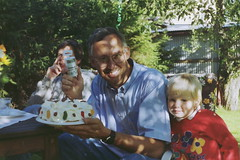 Dad fixing a special cake (sebilden) Tags: smile cake dad anders drills manic scannedfromnegative sebilden