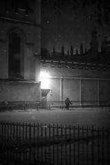 Twilight Whiles (rpgwhitelock) Tags: street city uk light shadow england blackandwhite bw snow man black cold building art college lamp monochrome beautiful mystery architecture night clouds dark lights mono evening frozen artwork alley streetlight darkness fineart streetphotography atmosphere falling alleyway oxford mysterious allsoulscollege radcliffe oxfordshire atmospheric shadowed allsouls numinous richardwhitelock twilightwhiles rpgwhitelock