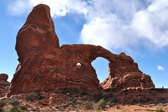 Grand - Closing In On Turrent Arch (Drriss & Marrionn) Tags: travel roadtrip lasal utah usa landscape outdoor blueskies cloud clouds sky skies rock mountain mountains canyon mountainside sandstone nature red crag cliff archesnationalpark moab rockformation arch naturalarch turretarch