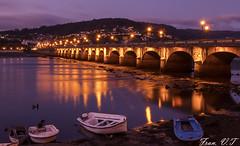 (cazador2013) Tags: noche mar puente arcadas luces reflejos barcas botes orilla costa agua cielo nubes nocturna
