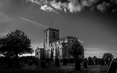Church of St Mary and St Hardulph, Breedon on the Hill. (Ian Emerson (Looking forward to a Scotland trip)) Tags: omot churchyard church headstone historic listed breedon hill architecture trees clouds blackwhite outdoor stonework tower flag canon 1855mm lightroom adobe