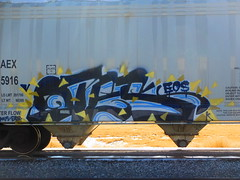 Otesk (magpiee) Tags: white black yellow train eos graffiti blues hoppers otes eatr otesk