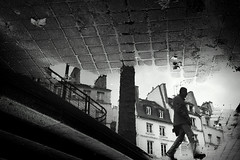 frame walk (sparth) Tags: november blackandwhite bw paris france reflection silhouette mirror blackwhite upsidedown noiretblanc sony down reflet reversed upside 2012 5eme parisfrance noirblanc rx100 walkingsilhouette november2012 sonyrx100