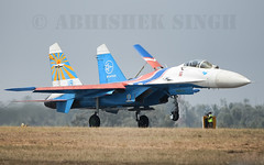 SU-27 Russian Knights (illuminativisuals.com) Tags: airplane flying wings aircraft aviation jets flight jet aerobatics sukhoi flypass airdisplay su27 fighterjets formationflying aeroindia russianknights bangaloreairshow illuminativisuals abhisheksinghphotography aeroindia2013