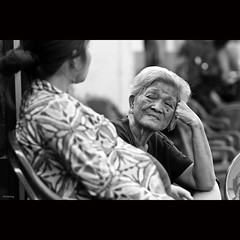 A conversation about her future baby (-clicking-) Tags: old portrait blackandwhite bw monochrome blackwhite mood faces emotion grandmother traces streetphotography streetlife pregnant vietnam elderly older aged talking visage oldtime eld nocolors oldface tracesoflife elderlyportrait bestportraitsaoi elitegalleryaoi tracesofage