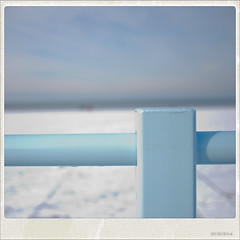 Out of the blue (Peter Jaspers) Tags: holland beach netherlands dutch fence polaroid coast seaside dof scheveningen olympus denhaag panasonic northsea fenced thehague lr lightroom zuidholland hff m43 mft southholland hofstad 2013 epl1 20mmf17 fencefriday happyfencefriday panasoniclumix20mmf17asph fencedfriday frompeterj© 113picturesin2013 113picturesin201376somethingblue