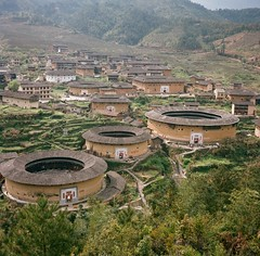 OOO (kymak) Tags: china red house mountain tower film architecture circle living village culture tourist round vernacular fujian hakka slope 2010  dwelling tulou   earthenbuilding  schneiderxenar3575 rolleiflex35a  modelk4a automat6x6 mxtype2
