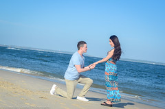 Sean and Bei (Kirsten Goebel of Pine Tree Productions) Tags: blue sky love beach water beautiful kneel engagement sand hands couple sydney wave breeze hold propose dollsbeach