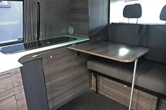 Van Interior (Leisure Hubs) Tags: lighting wood kitchen vw volkswagen shower tv bed rainforest conversion designer system dining comfort curved camper luxury campervan stylish reimo corian bebb