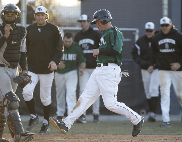 Senior Brandon Payne touches home with the game-winning run in game two, capping a four run ninth to earn the sweep over Bloomfield. Copyright 2013; Wilmington University. Photo credit: Tim Shaffer. All rights reserved.