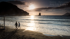 Walking on the beach at sunset (Andrea Rapisarda) Tags: beach spiaggia vulcano eolie nikon d750 2470mmf28 filtri sunset mare seascape allrightsreserved sicilia people walking tramonto