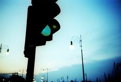 Urban at sunset (ale2000) Tags: lca xpro chrome lomographyxprochrome film analog analogue sunset trieste tramonto lights luci semaforo trafficlight greenlight verde lampioni poles illumination sky cielo blue blu shadesofblue