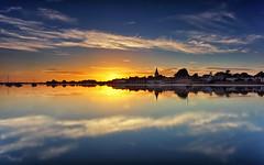 Golden Glow (Langstone Joe) Tags: boshamharbour westsussex chichester church sunset reflections longexposure firecrest yachts seascape landscape
