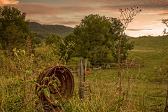 Rusty Wheel (buddybob24609) Tags: sunset farm field rustywheel mountains trees fence farmgate pinkclouds