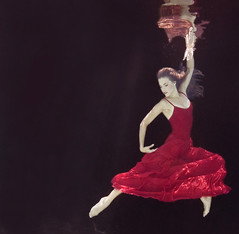 Dancer in red dress underwater (Tracy Kahn) Tags: red woman black water pool beautiful lady female swimming swim hair flying pretty underwater dress dancing floating peaceful dancer skirt serene form float submerged relaxed fit h20 laying