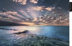Uprising (juandiegojr) Tags: morning seascape water clouds sunrise spain rocks muse malaga uprising rayoflight juandiegojr juandiegojrcom d800e nikond800e