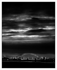 Crossing the Mersey (Gary Rowlands) Tags: leica sky bw monochrome digital landscape mono nightshot cheshire northwest transport memories bridges monochrom february connections runcorn widnes michaelkenna rivermersey wheretogo 2013 michaelkennalivedhere