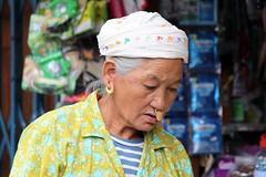 Bhutanese portrait (10b travelling) Tags: woman gold asia asien dragon bhutan kingdom jewelry jewellery asie nosering thimpu thunder himalayas bhoutan 2010 thimphu butan drukyul peopleset peoplefamilycarstentenbrink placesasiabhutan