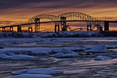 sunset, st. marys rapids / sault ste. marie international bridge (twurdemann) Tags: bridge winter sunset snow cold ice water evening unitedstates dusk michigan shoreline berm brilliance saultstemarie canadiannational soolocks fishladder internationalbridge usarmycorpsofengineers stmarysriver basculebridge verticalliftbridge circa1887 colorefex singhray graduatedneutraldensity niksoftware canadaunitedstatesborder stmarysrapids detailextractor americansaultlocks stmarysfallscanal gnd3s