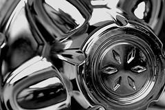 Seeing stars in hubcaps (Knitlitcamper) Tags: hubcap star chrome macro macromondays themestars