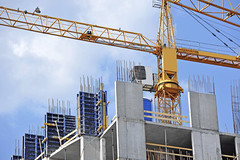 Crane and construction site (tim_kephart) Tags: construction crane residential building development built apartment architecture brick concrete estate flat highrise home house housing property realestate residence sky structure mortgage urban cement site blue jenny workplace dwelling scaffolding business hoist skyscraper work equipment frame mechanism reinforcement engineering multistory formwork folding beam decking deck casing cast curb mould