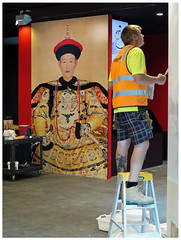 """Yin & Yang--Preparing for the Emperor"" - Melbourne, Australia (TravelsWithDan) Tags: candid streetphotography throughtheglass nationalgalleryofvictoria exhibit painter melbourne australia canong16 artmuseum worker yinyang"