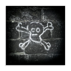 Underground Pirate (Paul Weller Photography) Tags: skullcrossbones pirate tunnel brick spray paint childish kettleness northyorkshire