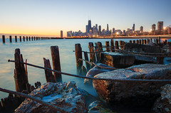 Sunrise Hates Me (Brian Koprowski) Tags: longexposure morning chicago cold ice skyline sunrise pentax sears jetty january chi pilings hancock frigid fullerton hdr willis breaker secondcity windycity chicagoist tamron1750f28 fullertonavenue pentaxk5 briankoprowski bkoprowski