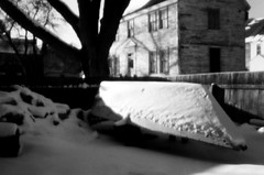 snow covered boat (pineconemonk) Tags: camera light bw copyright white snow black cold film mystery bulb analog digital lens toy lost hope holga exposure pin alone hole no tripod dream nh millennium pinhole dreaming plastic silence portsmouth act purity dmca f175 135pc