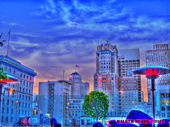 View from the Patio of The Cheesecake Factory, HDR (Walker Dukes) Tags: sanfrancisco california pink blue sunset red sky urban orange black tree green glass collage skyline clouds photoshop canon lights downtown neon cityscape skyscrapers purple violet flags photograph montage handheld barrier sfbayarea lamps unionsquare saksfifthavenue photomatix canons95
