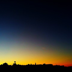 sunset colors (SS) Tags: camera blue light sunset red sky black apple colors yellow contrast 4 silhouettes september contrails 2012 iphone iphoneography ss