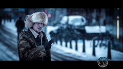 Soldier (Jeff Krol) Tags: street winter urban snow cinema cold netherlands canon movie fur soldier eos still bokeh candid streetphotography 85mm cigar denhaag f18 cinematic 169 thehague moviestill extravagant militairy 2013 ef85mmf18usm img0550 60d canon60d jeffkrol