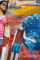 Young woman blending in with the grafitti in the background (Arno Enzerink) Tags: pink woman color colour colors girl sunglasses wall shirt lady female painting one colorful alone colours grafitti adult background young jeans purse single only shorts colourful copyspace handbag striped blend blending