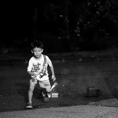 Play (grass-lifeisgood) Tags: street new boy portrait childhood canon fun happy kid child play fireworks expression year joy chinese run 100mm malaysia lunar facial ef johor f28l