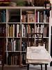 Bookshelf and chair (blinkypalermo) Tags: pen chairs library books olympus bookshelf 365 tote 2013 panasonic14mm