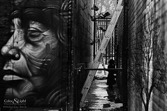 Imagination (Neerod [ www.colorandlightphotography.com ]) Tags: door blackandwhite toronto bar see alley chinatown lock vision graffitti imagine bnw