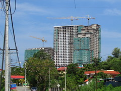 Platinum Tower (1 Sulaman) Construction (thienzieyung) Tags: road new morning travel blue trees windows sky tower clouds buildings construction apartments view towers places front cranes roofs wires views malaysia balconies kotakinabalu suburbs tall geography complex development forests sabah condominiums cladding slopes sepangar menggatal thienzieyung 1sulaman platinumtower
