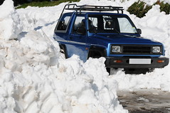 The aftermath, Jersey. (alagz@mac.com) Tags: uk winter snow abandoned ice nature rural landscape trapped aftermath stuck 4x4 britain nobody telephoto trinity freeze jersey british channelislands snowbound diahatsu victoriavillage