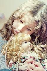 Jazz and her doll (Jazz Panda) Tags: baby brown cute love eyes doll sweet jasmine curls babygirl babydoll hugs