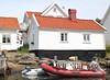 Waterfront cottage (K Nilsen) Tags: red orange white house black coast boat wooden waterfront sweden cottage coastal sverige motorboat bohuslän tiledroof grundsund västkusten summerhome skaftö