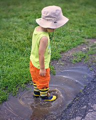 Puddle and fireman boots (Scott SM) Tags: galoshes rubber boots water puddle splash fireman firefighter hat john heinz national wildlife refuge tinicum mud 25 two year old toddler