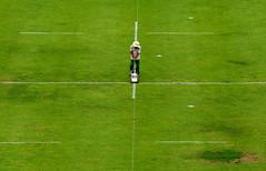 at the crossroads (jolantamazur) Tags: man painting lines grass negativespace highvantagepoint highview green geometry symmetry padang field