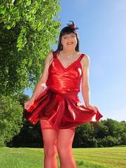 Short skirt (Paula Satijn) Tags: sexy hot girl gurl tgirl tranny transvestite red skirt dress silk silky satin shiny summer outside sunshine happy smile stockings stockingtops legs hat fascinator miniskirt