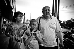 Family Resemblance (stimpsonjake) Tags: nikoncoolpixa 185mm streetphotography bucharest romania city candid blackandwhite bw monochrome family parents child son mother father mom dad faces