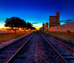 Neon Katy (Tom Haymes) Tags: railroad pink blue sunset vanishingpoint texas katy dusk tracks unionpacific silos katytexas ricesilos