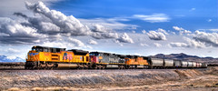 Train, Train. (Adam's Attempt (at a good photo)) Tags: railroad blue red white mountains clouds train utah weeds nikon flag bluesky engines unionpacific d200 redwhiteandblue hdr railcars railroadtracks usaflag uprr westdesert photomatix 6199 traintrain 8409 lr4 ponyexperssroad