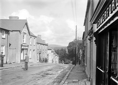 View of a village street, with pedestrians, in an unidentified location = Rathdrum, Co. Wicklow! (National Library of Ireland on The Commons) Tags: street ireland 20thcentury wicklow glassnegative leinster megazoom rathdrum comerford nationallibraryofireland fergusoconnor locationidentified limerickbybeachcomber fergusoconnorcollection barryshotel