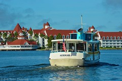 Cruising the Lagoon (Scottwdw) Tags: travel blue vacation sky water boat orlando nikon wake florida flag resort american transportation waltdisneyworld grandfloridian motorcruiser sevenseaslagoon mermaidi d700 scottthomasphotography afsnikkor28300mmf3556gedvr